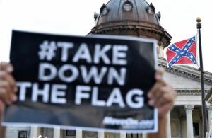 477933854-hundreds-of-people-protest-against-the-confederate-flag.jpg.CROP.promovar-mediumlarge-1
